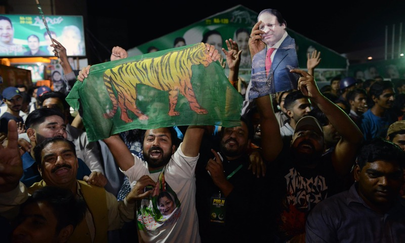 PML-N activists celebrate Kulsoom Nawaz's victory in the by-election in Lahore. —AFP