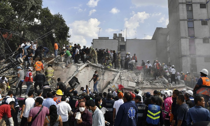 Rescue teams look for people trapped in the rubble after an earthquake in Mexico City. —AFP