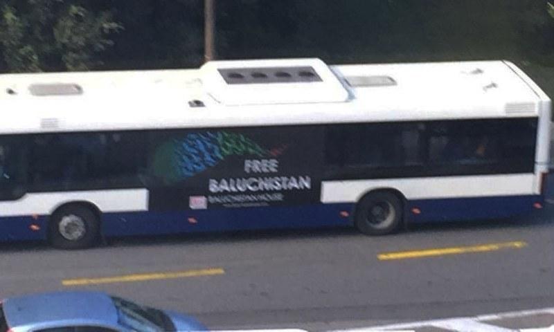 "A bus in Rue de Ferney of Grand Sacconex with the ""Free Baluchistan"" poster on it.—<em>DawnNews</em>"