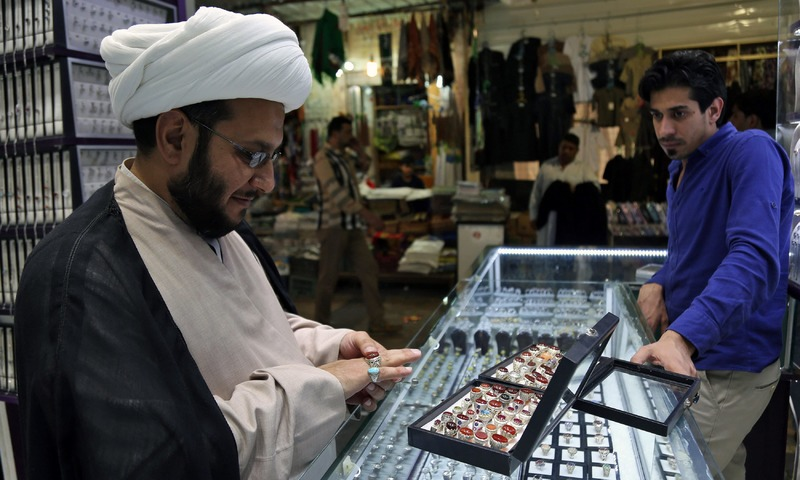 A cleric tries on a ring at a jewellery shop. —AFP