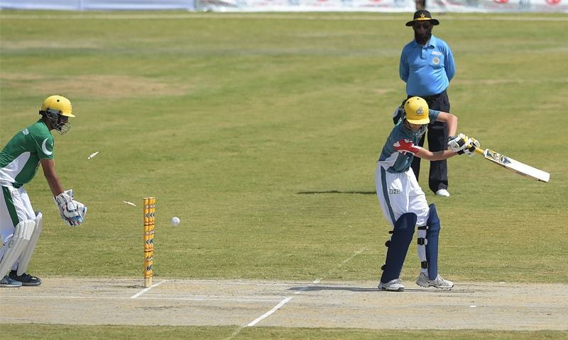 A UK Media XI batsman is bowled out as Pakistan XI wicketkeeper Yasir Hameed looks on during the match on Thursday.—AFP