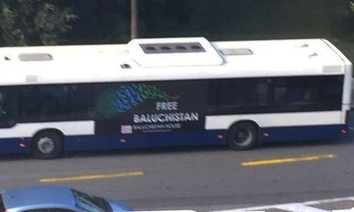 "A bus in Rue de Ferney of Grand Sacconex with the ""Free Baluchistan"" poster on it. —DawnNews"