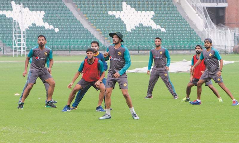 LAHORE: Pakistan cricketers play football during a training session at the Gaddafi Stadium on Saturday.—AP