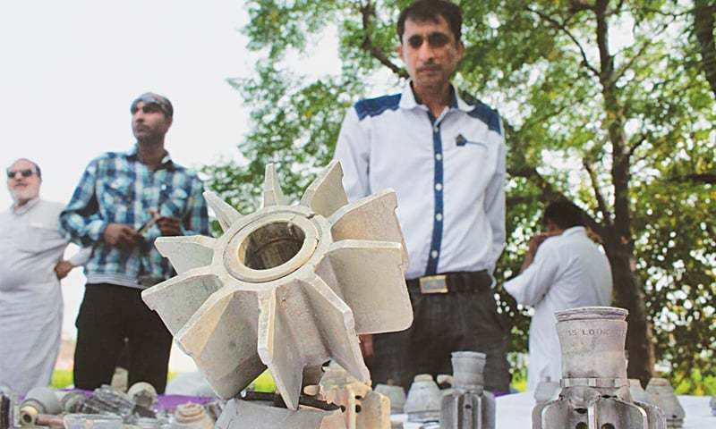 PEOPLE of a village hit by Indian shelling look at parts of mortar shells.—Online