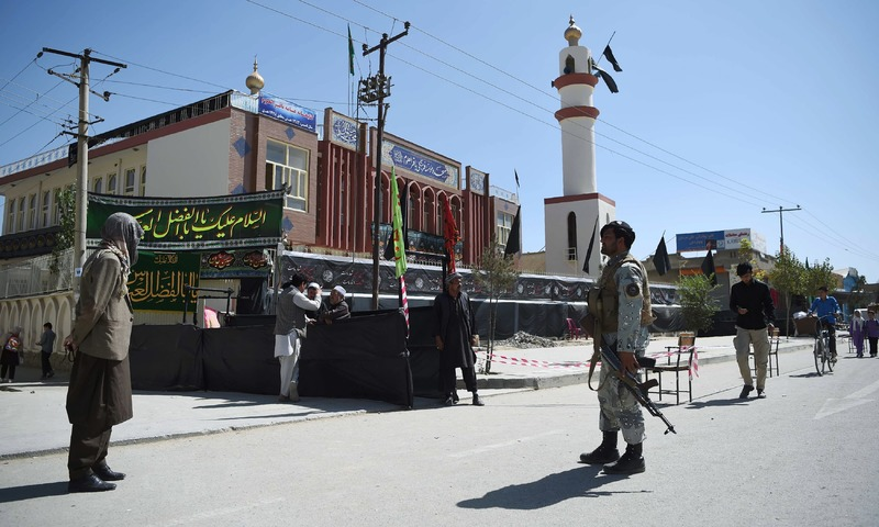 A policeman stands guard outside the Baqir-ul-Uloom mosque ahead of Ashura in Kabul. —AFP