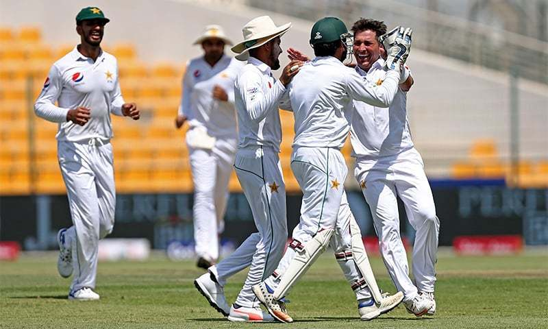 Yasir Shah (R) celebrates after taking the wicket of Sri Lanka's Lahiru Thirimanne on the first day of the first Test cricket match between Pakistan and Sri Lanka at Sheikh Zayed Stadium in Abu Dhabi on Thursday.— AFP