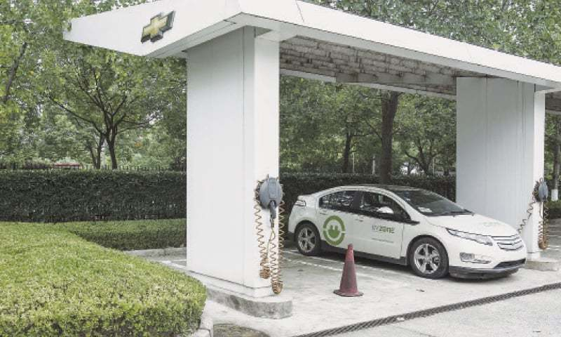 SHANGHAI: A Chevrolet Volt electric vehicle sits parked at a charging station at the General Motors China headquarters on Sept 15.— Bloomberg photo by Qilai Shen