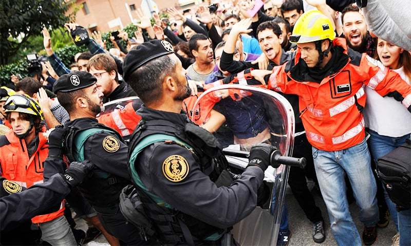 Nearly 350 injured in police crackdown at polling stations in Catalonia