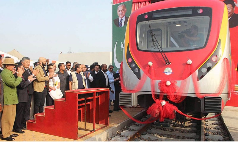 Shahbaz Sharif inaugurates the first set of bogies of the Orange-Line Metro  during a ceremony at Deera Gujjran. —APP