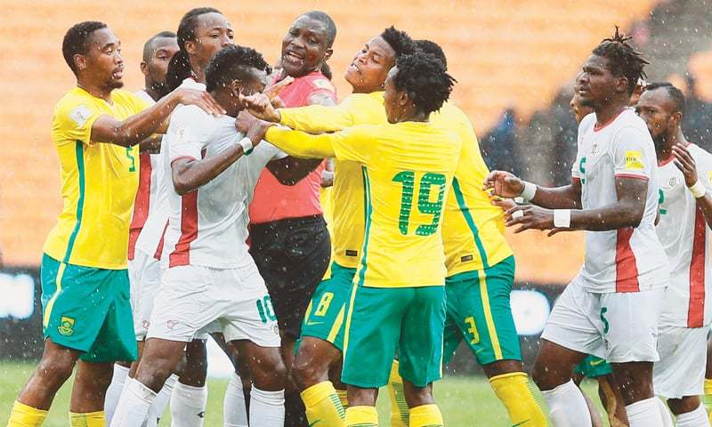 JOHANNESBURG: Cameroonian referee  Alioum Neant (C) attempts to separate scuffling players during the 2018 World Cup qualifier between South Africa and Burkina Faso at Soccer City.—AFP