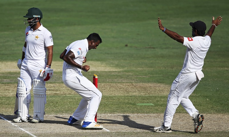 Sri Lanka's Lahiru Gamage celebrates dismissal of Pakistan's Sami Aslam during their fourth day at Second Test cricket match in Dubai, United Arab Emirates, Monday, Oct. 9, 2017. —AP