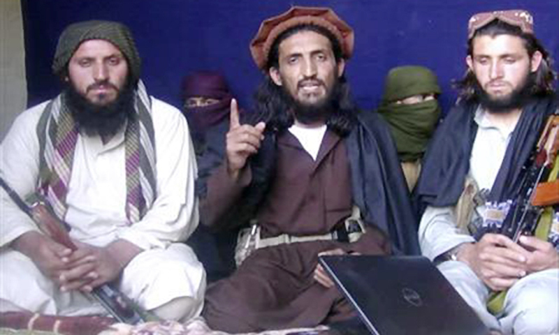 Omar Khalid Khorasani is seen in the centre during an interview in Mohmand tribal region on June 2, 2011. —Reuters/File