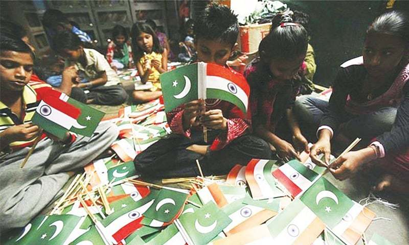 Youngsters attach flags of Pakistan and India together for a peace initiative that was launched simultaneously in both countries. The Peace Now and Forever Campaign Between Pakistan and India grew out of a Whatsapp group and brought together journalists, political activists, retired government and military officials, writers, artists and youth activists keen to improve bilateral relations between the two countries | Reuters
