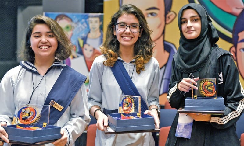 Winner of the Spelling Bee contest Mariam Khan Wazeer, (C) poses with runner-up Nirvana Amjad (R) and second runner up Zayneb Moin (L) on Saturday. — Photo by Tanveer Shahzad