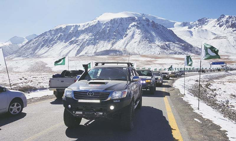 KHUNJERAB: Pakistan flags line the highway as motorists set off for the 3,000-kilometre-long Pakistan Motor Rally on Saturday morning. The arduous journey will take the participants through parts of Gilgit-Baltistan, Khyber Pakhtunkhwa, Punjab, Sindh and Balochistan. The rally is scheduled to end in Gwadar on the last day of this month.—Dawn
