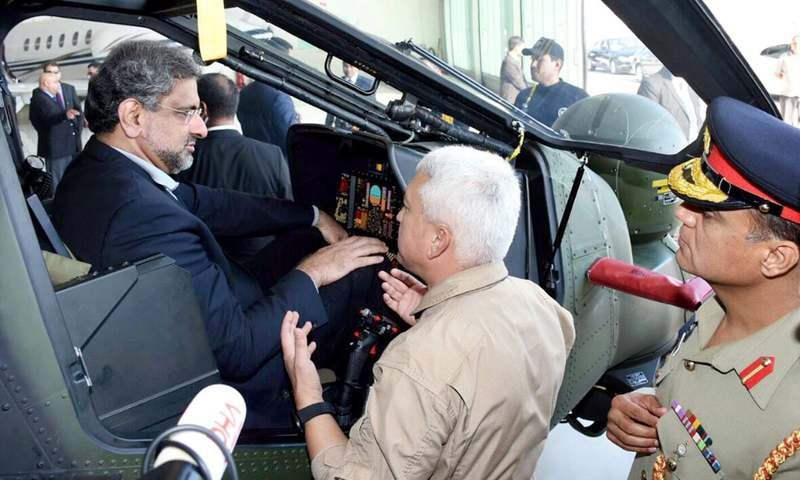 Shahid Khaqan Abbasi inspects the Turkish combat helicopter. —Online