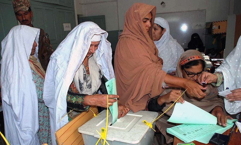 Women cast their votes at a polling station during by-election in NA-4 constituency. —APP