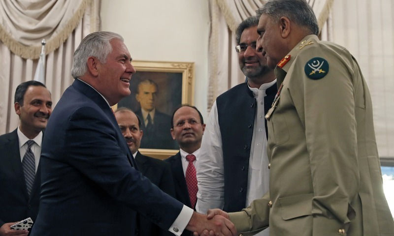 US Secretary of State Rex Tillerson shakes hands with Chief of Army Staff Qamar Javed Bajwa, with Prime Minister Shahid Khaqan Abbasi, centre right on Tuesday in Islamabad.— AP/File