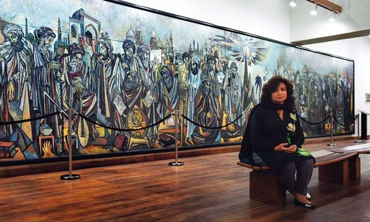 Dr Asma Ibrahim sits in front of a mural by Sadequain in the State Bank Museum gallery in Karachi | Photos by Tahir Jamal / White Star
