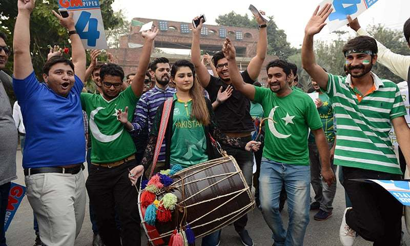 Pakistani spectator cheers prior to the start of the T20 cricket match playing between Pakistan and Sri Lanka at the Gaddafi Cricket Stadium in Lahore on October 29, 2017.
