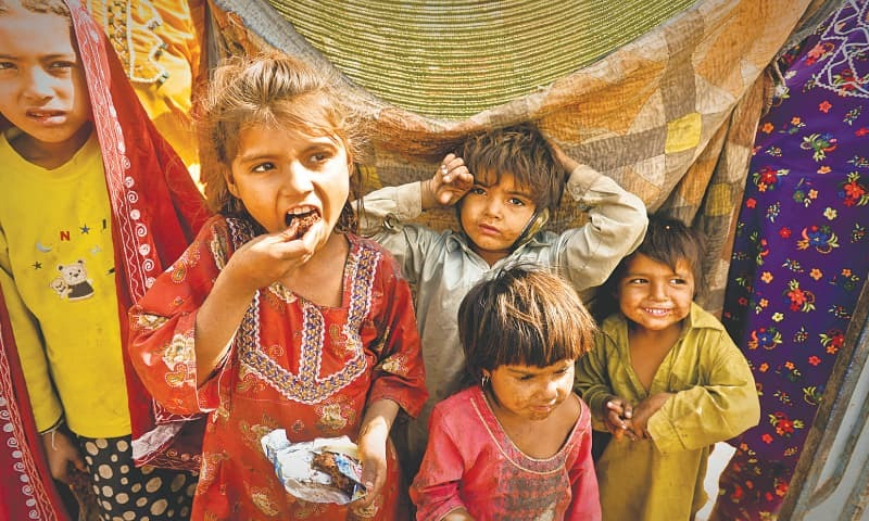 A GROUP of children eating gutka in a slum.—Fahim Siddiqi / White Star