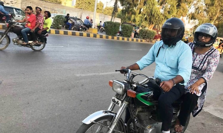 Given social pressures, it's naturally a struggle when you force yourself to defy the norm and sit on a motorbike the way men sit