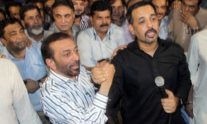 Mustafa Kamal and Farooq Sattar shake hands as they announce the formation of a political alliance. —PPI