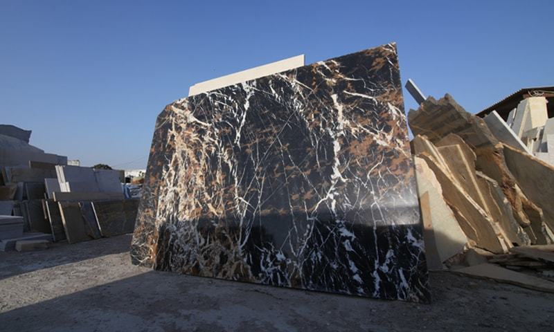 Large slabs of marble such as this one are a rare sight in Marble City, Gadani. Most international clients demand larger slabs than smaller pieces since they can be used in a variety of ways | Photos by Basil Andrews
