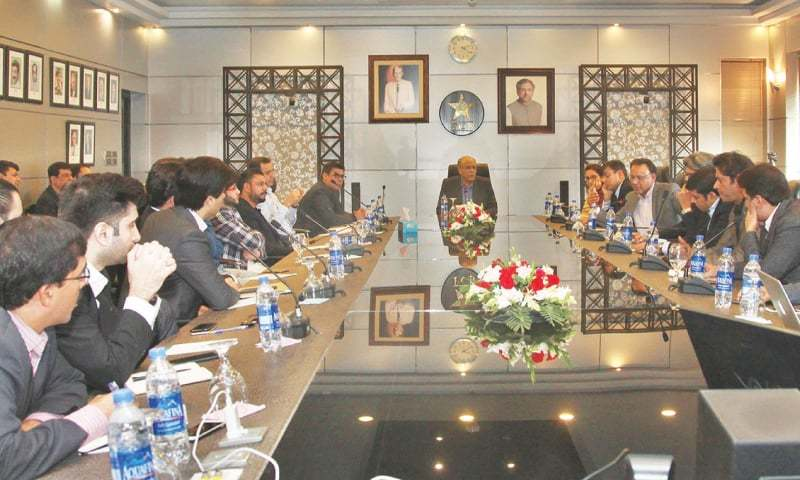 LAHORE: PCB chairman Najam Sethi (C) holds a meeting with owners of Pakistan Super League franchises at the Gaddafi Stadium on Monday.—Courtesy PCB