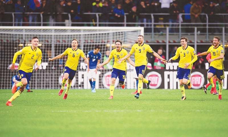 MILAN: Sweden players revel in their qualification to the 2018 FIFA World Cup after their playoff against Italy at the San Siro Stadium.—AFP