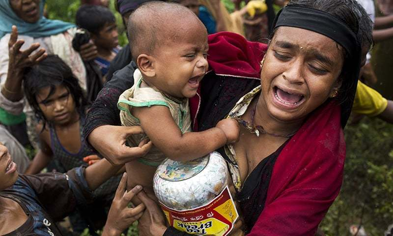In this Sept. 8, 2017, photo, a Rohingya woman breaks down after a fight erupted during food distribution by local volunteers at Kutupalong, Bangladesh, Friday, Sept. 8, 2017. The massive refugee camp in Kutupalong was set up in the early 90s to accommodate the first waves of Rohingya Muslim refugees who started escaping convulsions of violence and persecution in Myanmar. Don't expect the United States to step in and resolve what is increasingly being describing as an ethnic cleansing campaign against Myanmar's dow