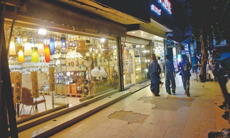 a row of shops selling electric light fixtures on M.A. Jinnah Road.