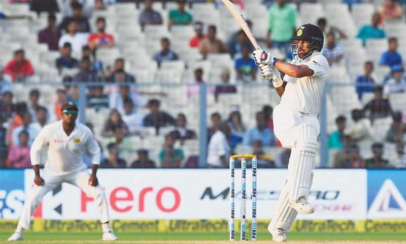 KOLKATA: Indian opener Shikhar Dhawan plays a shot during the first Test against Sri Lanka at the Eden Gardens on Sunday.—AFP