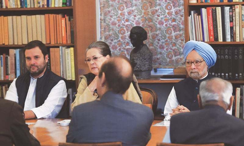 Congress chief Sonia Gandhi (centre), vice president Rahul Gandhi (left) and former prime minister Manmohan Singh (right) look on during a meeting of the  party's working committee on Monday.—AFP