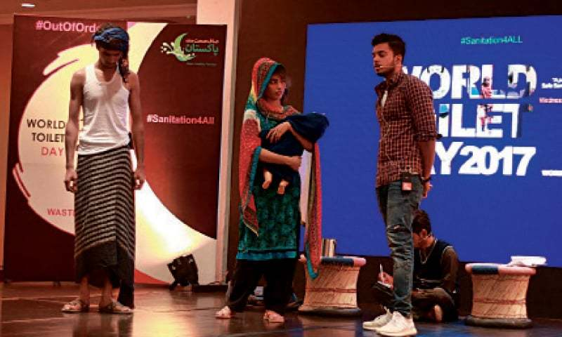 Students perform a tableau on the World Toilet Day. — Online