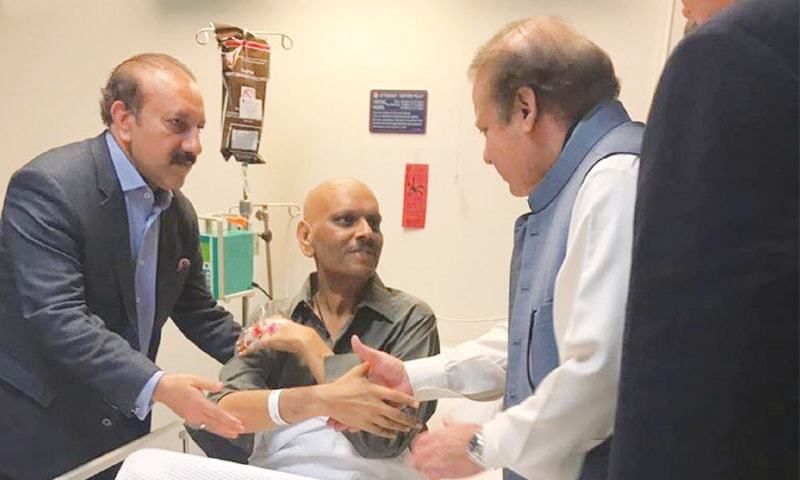 ISLAMABAD: Chief of the Pakistan Muslim League-N Nawaz Sharif meets his party's member of the National Assembly Rajab Baloch at a hospital on Wednesday.—INP