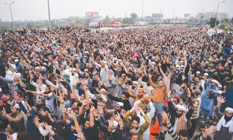 ISLAMABAD Activists of the Tehreek Labbaik Ya Rasool Allah shout slogans on a blocked flyover during the sit-in on Friday.—AFP