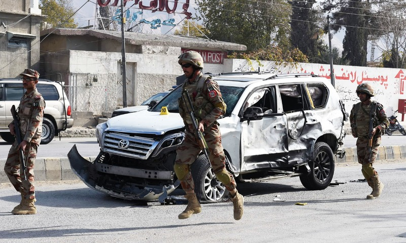 Soldiers arrive at the site of a suicide bombing in Quetta. — AFP