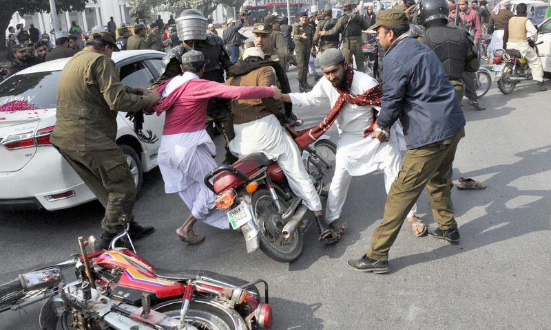 Police arrest religious activists during protest in Lahore. —Online