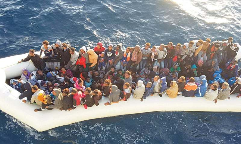 Tripoli: Migrants arrive at a naval base after they were rescued by the Libyan coastal guard.—Reuters