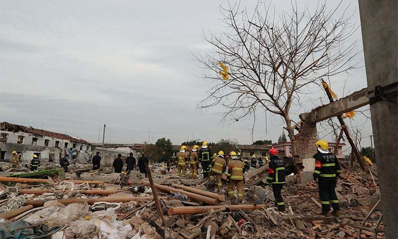 Rescue workers search at the site of an explosion in Ningbo, China's eastern Zhejiang province.─AFP