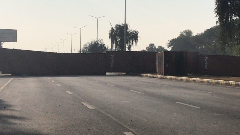 Containers were placed on Faizabad Interchange on protesters' demand, after initially being removed in the morning.— DawnNews