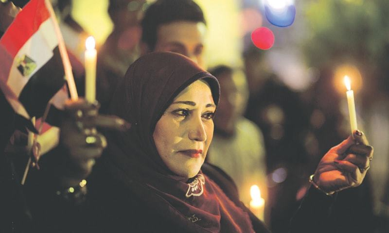 Egyptian journalists hold candlelight vigil to mourn victims of deadly mosque attack