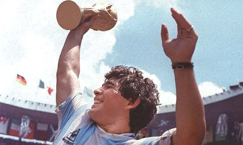 Diego Maradona, the 25-year-old captain of the 1986 Argentinean team, with the FIFA World Cup trophy | AFP