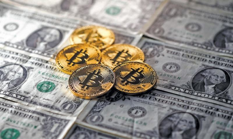 BITCOINS placed on dollar banknotes are seen in this illustration picture.—Reuters