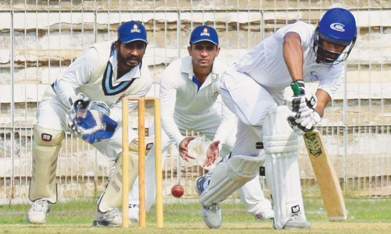 HYDERABAD: UBL opener Shan Masood offers a defensive bat during his 75-run knock as SSGC wicket-keeper Maqbool Ahmed and Asif Zakir look on in the Super Eight round match of the Quaid-i-Azam Trophy National Cricket Championship at the Niaz Stadium on Sunday.—INP