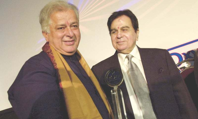 In this June 2, 2005 file photo, legendary Bollywood actor Dilip Kumar (right) looks at veteran actor Shashi Kapoor at the inauguration of a new cinema in Mumbai.—AP