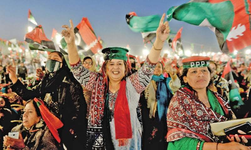 PPP activists in a joyous mood during the party's public meeting in Islamabad on Tuesday. — Photo by Mohammad Asim