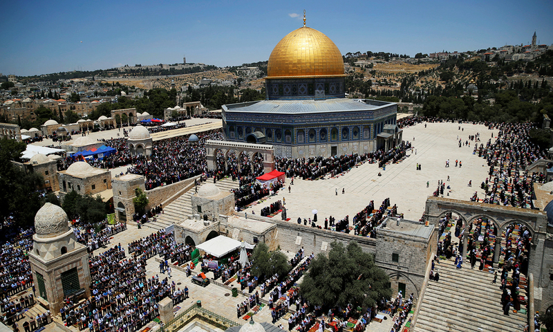 The Dome of the Rock is seen in the background as Palestinians pray in Jerusalem's Old City. Reuters/File