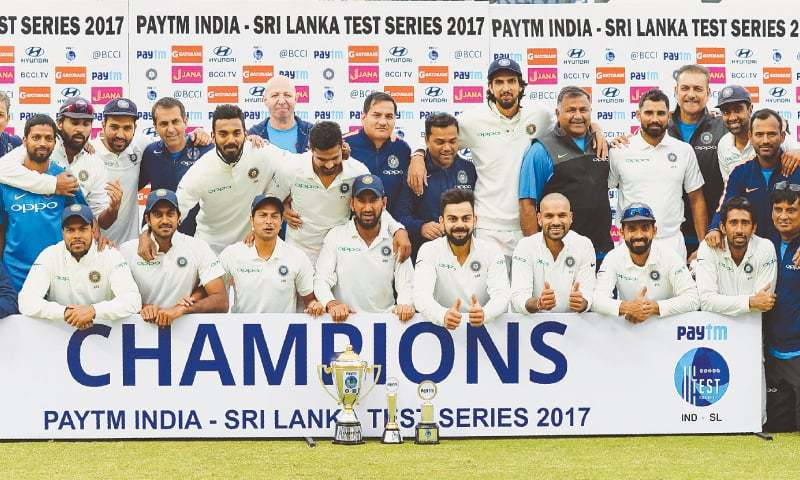 NEW DELHI: Members of the Indian squad pose with the trophy after winning the Test series against Sri Lanka at the Feroz Shah Kotla Stadium on Wednesday.—AFP